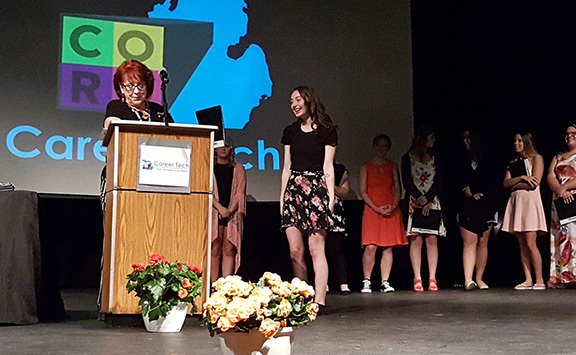 student receiving award from Cosmetology