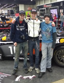 automotive students pose by new car at the AutoRama car show in Detroit